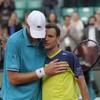 Marathon man Isner beaten in fourth longest in Grand Slam history