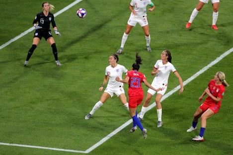 USA's Christen Press (centre) scores her side's first goal.