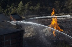 Fire at US Jim Beam warehouse destroys 45,000 barrels of bourbon, as alcohol flows into river