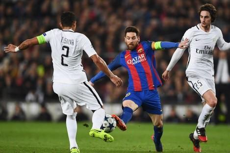 Lionel Messi pictured competing against Thiago Silva.