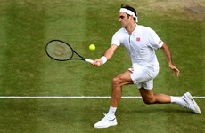 Semi-final bound Federer makes history with 100th Wimbledon win