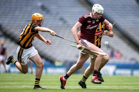 Galway's Greg Thomas with Tristan Roche of Kilkenny.