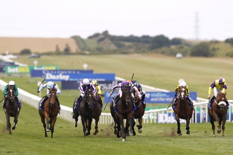 Winner alright: Ten Sovereigns (centre), in the hands of Ryan Moore, takes the July Cup.