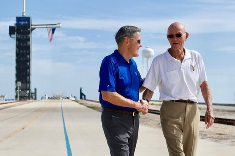 Michael Collins, right, speaks to Kennedy Space Center Director Bob Cabana at Launch Complex 39A