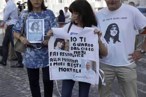 Reanta Grattani, a friend of the Orlandi family, holds a sign with photos of Emanuela Orlandi and Pope Francis and a message stating: 'I'm watching you from the sky, but you (referring to Pope Francis) please let them return my mortal remains to my mother.'
