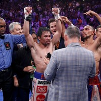 Pacquiao wins WBA welterweight title at 40 with split-decision victory over Thurman