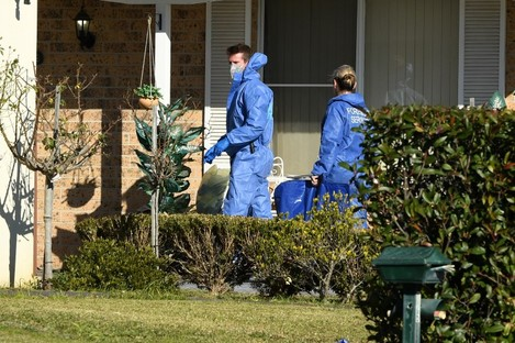 Police officers have established a crime scene at the house in St Clair, Sydney.