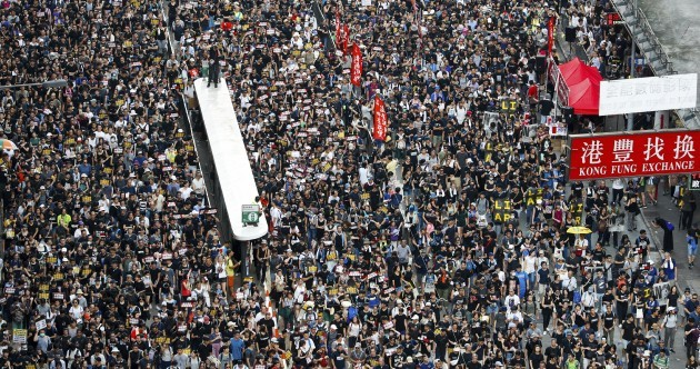 Tens of thousands march in another huge anti-government rally in Hong Kong