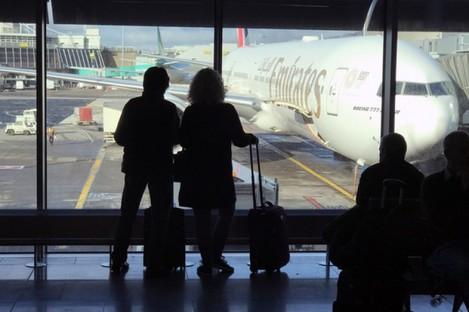 Passengers wait for their flight at Dublin Airport.