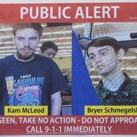 Armed police and tracker dogs search for missing teen murder suspects in remote Canadian forest