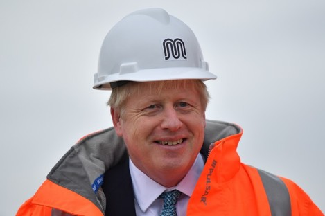 UK Prime Minister Boris Johnson meets engineering graduates on the site of an under-construction tramline in Stretford, greater Manchester