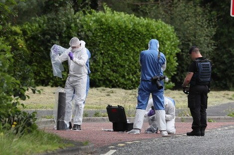 Ammunition technical officer and forensic officers in Tullygally Road, Craigavon, Co Armagh following the incident