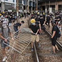 Thousands of Hong Kong protesters march despite police ban