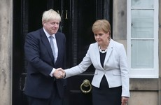 Boris Johnson gets booed as he arrives at Bute House to speak with Nicola Sturgeon