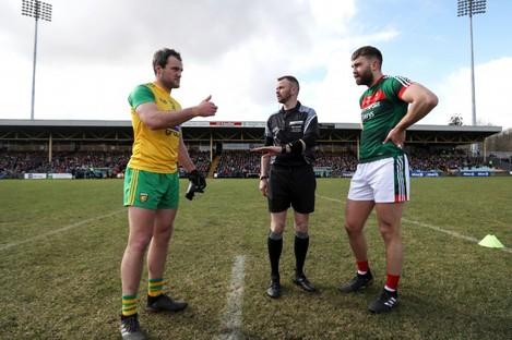 Michael Murphy and Aidan O'Shea at the coin toss during their league encounter.