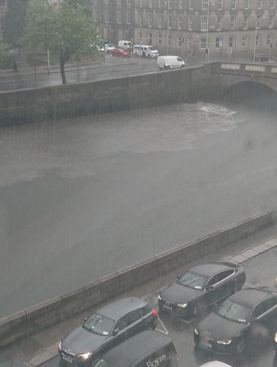 Sewer debris discharges into River Liffey after heavy downpours yesterday