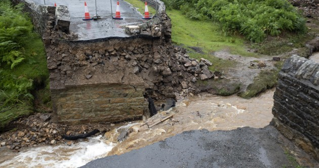 Bridge collapses in England as areas are hit by severe flooding