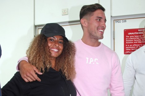 Love Island winners Amber Gill and Greg O'Shea arriving at Stansted Airport