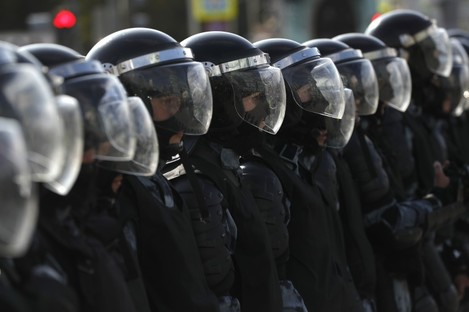 Police block a street during a protest in Russia.