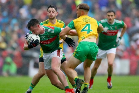 Donegal's Ryan McHugh and Stephen McMenamin with Cillian O'Connor.