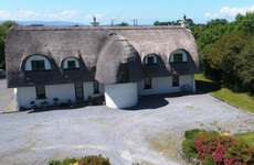 Escape to the seaside at this modern thatched residence next to Galway Bay