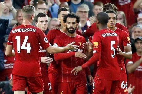 Liverpool's Mohamed Salah (centre) celebrates scoring.