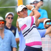 McIlroy stays in touch with leader Reed in New Jersey while Lowry keeps steady