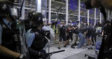 Chaos at Hong Kong airport as riot police clash with pro-democracy protesters staging sit-in