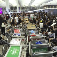 How escalating tensions in Hong Kong have brought one of the world's busiest airports to a standstill