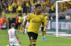 England star Sancho helps Dortmund stroll past Augsburg to go top of the Bundesliga
