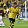 England star Sancho helps Dortmund stroll past Augsburg to go top of the Bundesliga