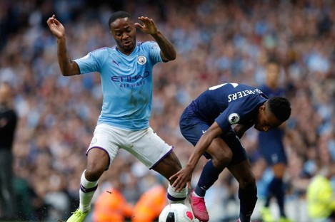 Manchester City's Raheem Sterling (left) and Tottenham Hotspur's Kyle Walker-Peters battle for the ball.