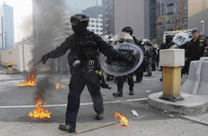 Hong Kong police fire tear gas as clashes return to city following days of peace