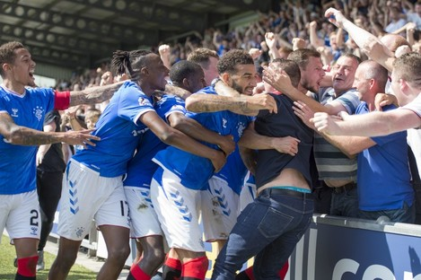 Rangers players and fans celebrate together after Borna Barisic's winner.