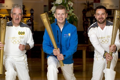 Patrick Kielty (centre) celebrates carrying the Olympic Flame with fellow Northern Irish Torchbearers (009) Tony Fearon (left) and Ryan Miskelly on behalf of Samsung.