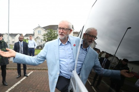 Labour leader Jeremy Corbyn gestures as he leaves after viewing the fire damaged Woodmill High School during a visit to Dunfermline, on the first day of a three day tour of Scottish constituencies.