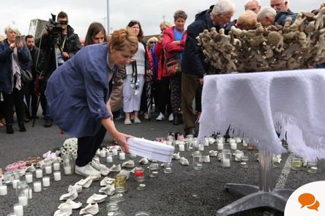 Historian Catherine Corless placing a baby coffin at a shrine for the Tuam babies last year.