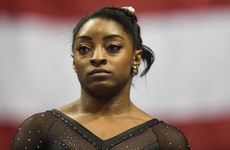 Brother of gymnast Simone Biles charged over triple murder in US