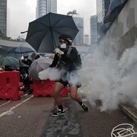 Police fire tear gas and water cannon as Hong Kong protesters defy rally ban