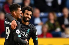 Liverpool stroll to record-breaking win against Burnley