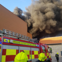 Firefighters battle large blaze at Cork shopping centre
