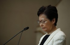 Hong Kong leader vows to stay on despite leaked recording