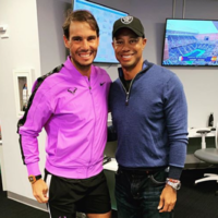 Nadal books quarter-final spot while 'idol' Tiger Woods watches from the stands