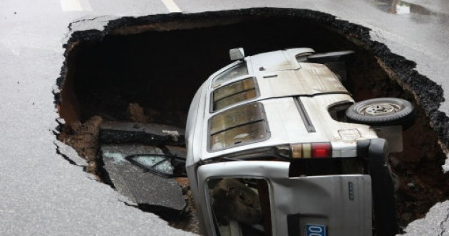 In pictures: Van trapped after road suddenly caves in