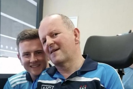 Seán Cox pictured with his son Jack watching Sunday's All-Ireland final.
