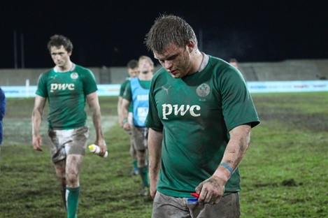 Dejected Irish players leave the field.