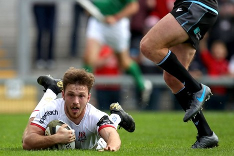 Graham Curtis slides in for an Ulster try.