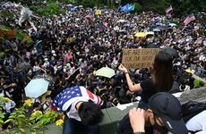 Hong Kong protesters march to US consulate to increase pressure on Beijing