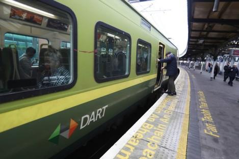 A passenger boarding the DART.