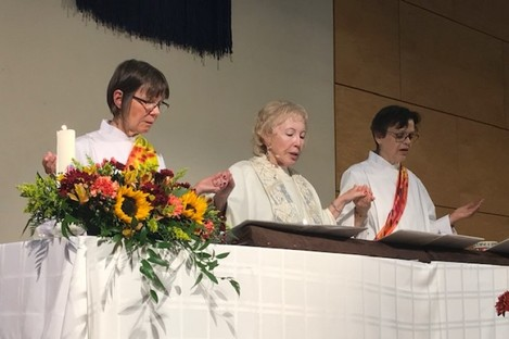 Bridget Mary Meehan (centre) saying Mass